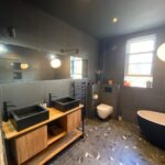 bedroom to bathroom conversion making use of a larger space to create your perfect bbathroom