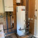New Boiler in Yorkshire. Complete heating system fitted including Vaillant Ecotec Plus, Gledhill unvented cylinder with remote expansion vessel, system zone valves and wiring. all pipework clipped to plywood back and covered in pipe insulation where appropriate
