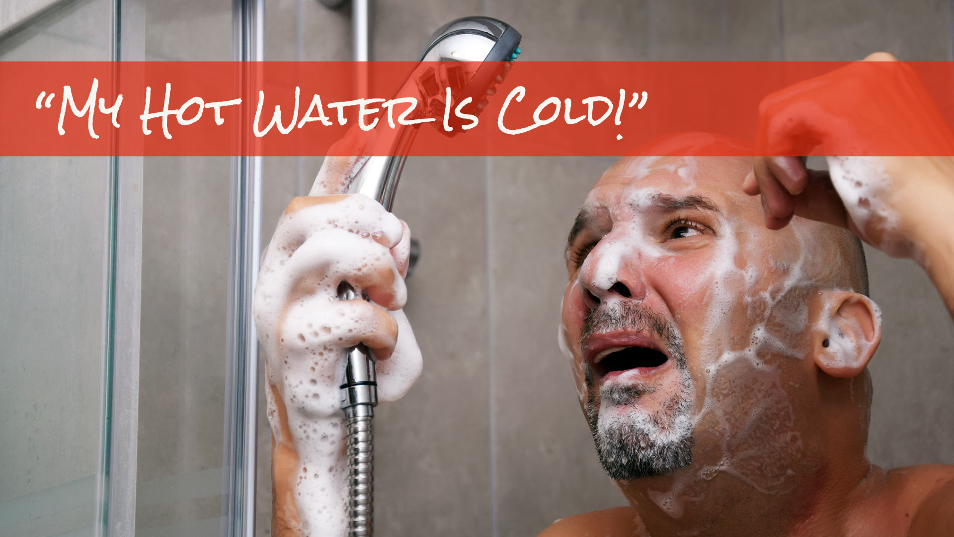 My hot water is cold man standing in shower with soap over face looking at shower head