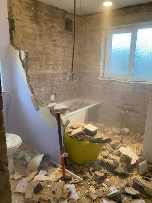 Straight swap bathroom removing partition wall between cloakroom and bathroom to create one large bathroom with large window