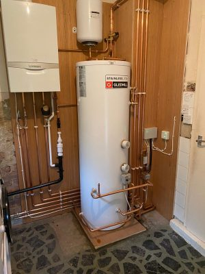 Complete heating system fitted including Vaillant Ecotec Plus, Gledhill unvented cylinder with remote expansion vessel, system zone valves and wiring. all pipework clipped to plywood back