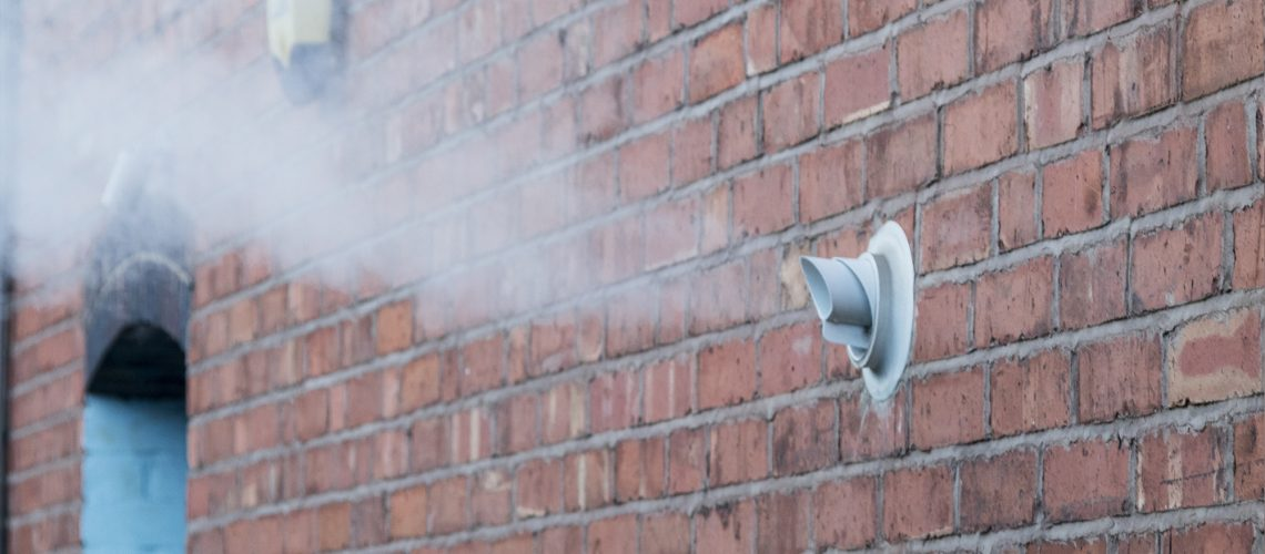 a large plume of water vapour from a boiler flue could look like a boiler on fire