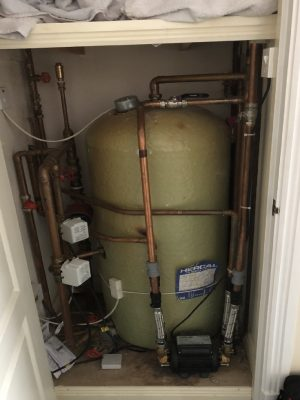 an old stored hot water cylinder in an airing cupboard