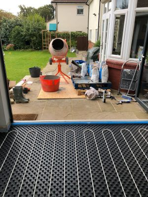 nu-heat underfloor heating screed being mixed and prepared