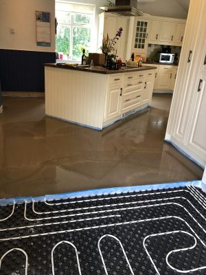 Laying screed over nu-heat underfloor heating installatioin