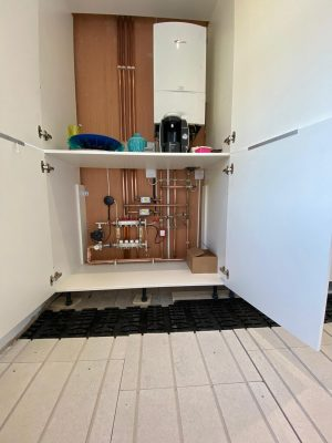 Parkstone Heating installation showing oiler, pipework, Solfex manifold and solfex underfloor heating boards