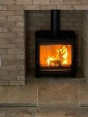 rick-slip tiles over old chimney breast and Aspect 8 Slimline SE Woodburning Stove installed