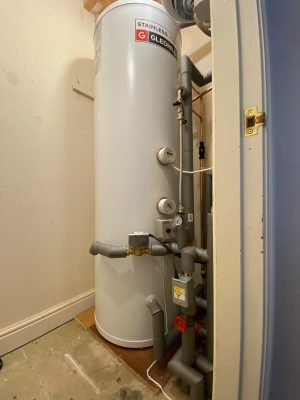 Boiler and cylinder upgrade new unvented cylinder in existing airing cupboard