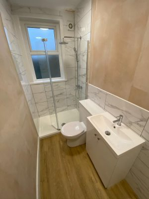 Narrow bathroom space used effectively with a shower instead of bath