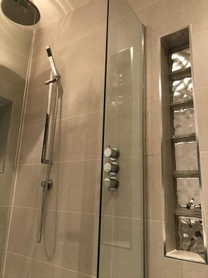 Bathroom renovation shower with concealed fittings and cube glass window feature