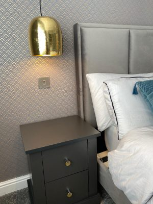 kitchen to bedroom conversion bedroom bedside table with drawers and ceiling mounted gold lampshades