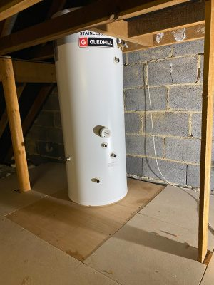 new unvented cylinder located on strengthened floor in loftspace before fitting pipework and components