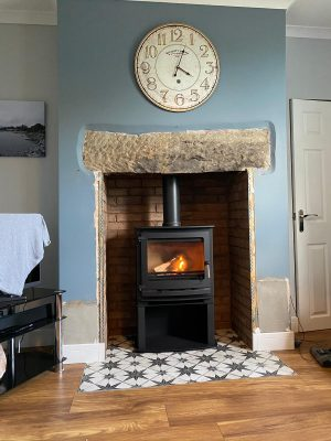 Dunsley Heat Advance 500 Stove installation complete with fireproof lined opening covered with brick slipped tiles